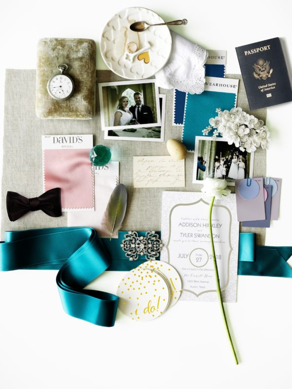 flat lay featuring fabric swatches, ribbon, mementos and accessories for the bride and groom