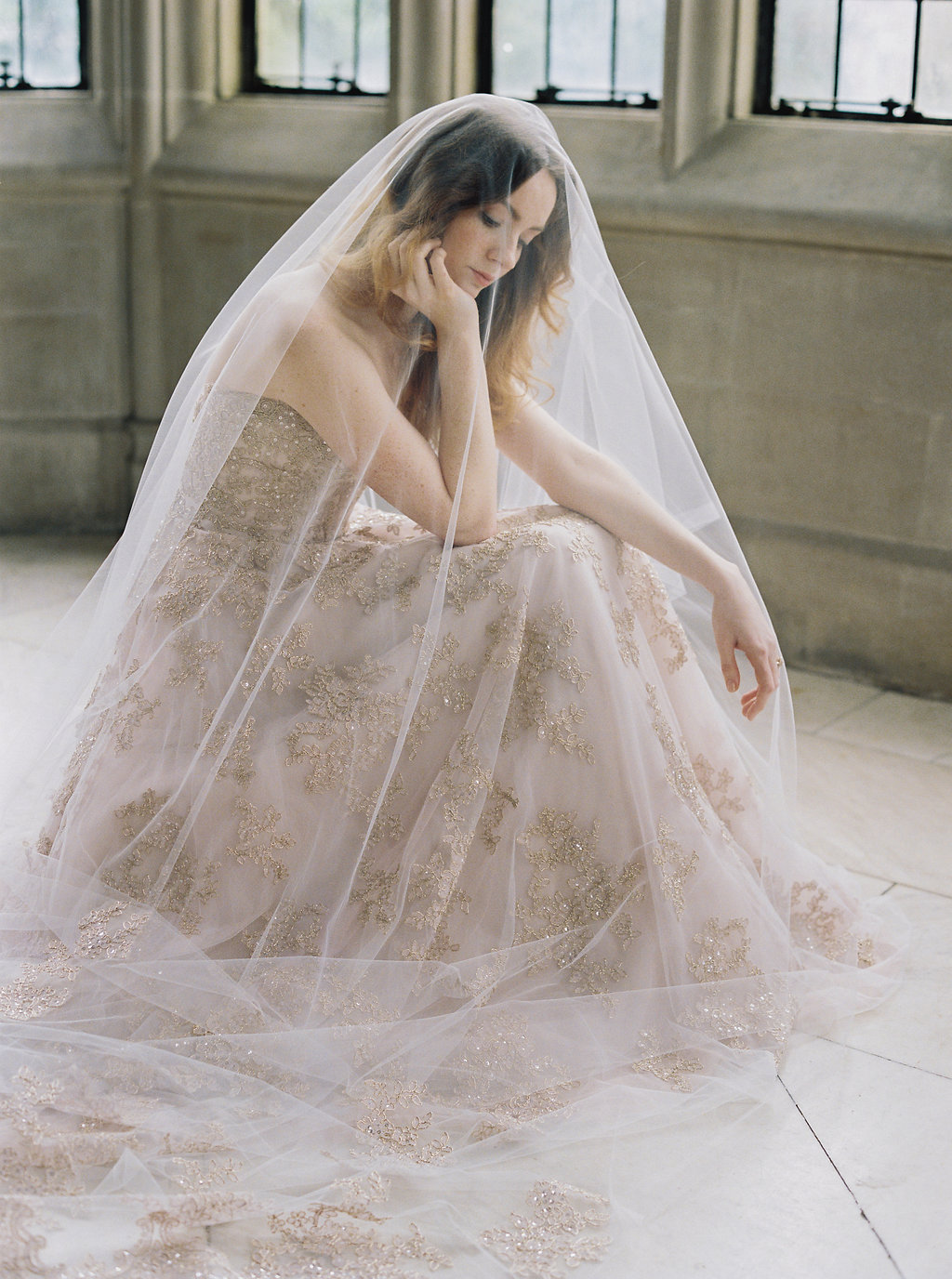 Bride in blush colored wedding gown and veil