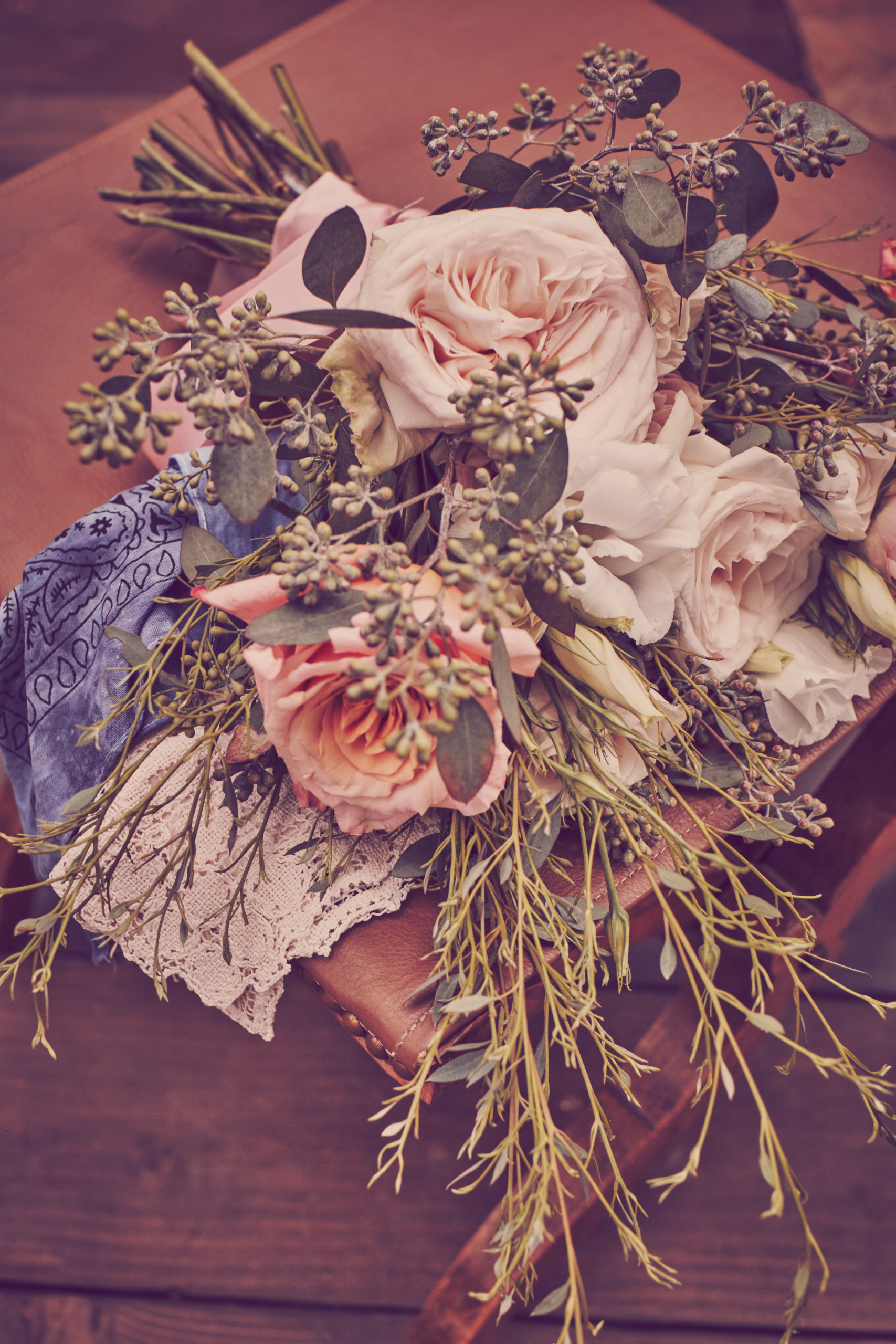 Rustic wedding flower bouquet laying on leather seat