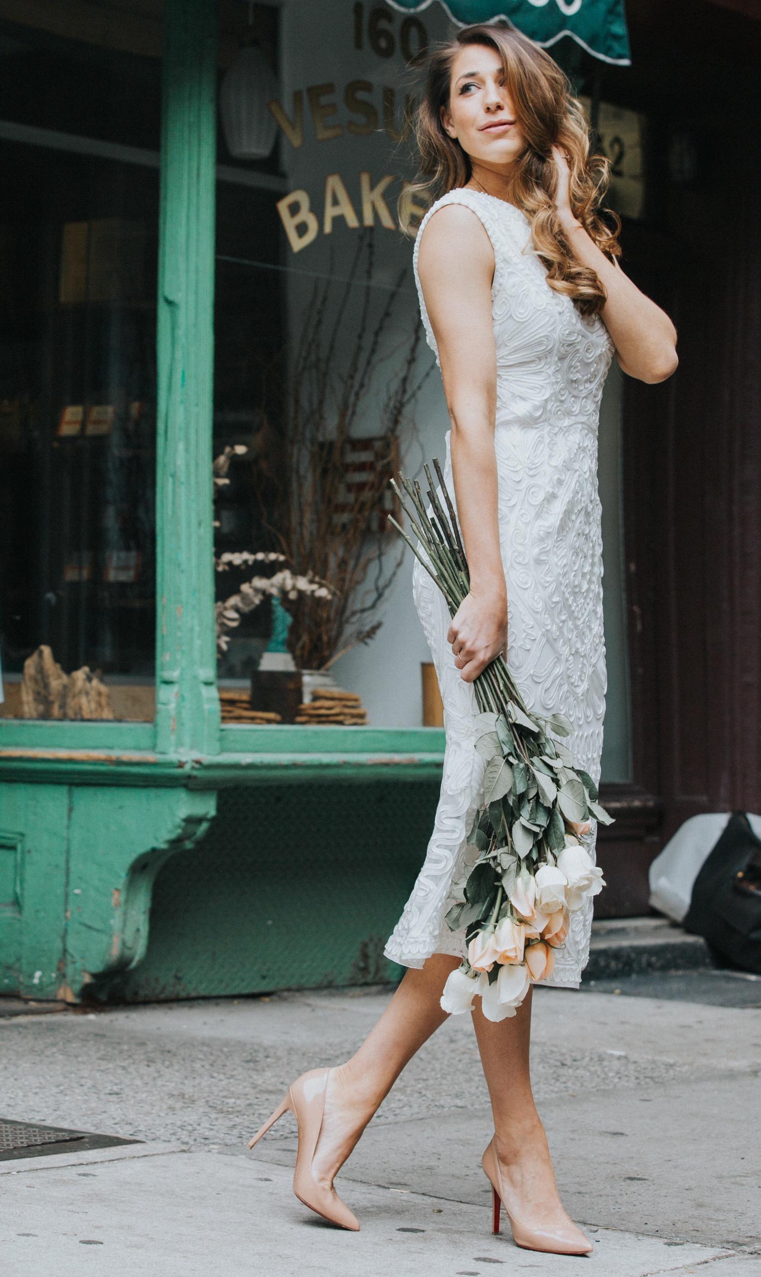 Andrea from A Slice O Pi calls this ribbon-embellished midi dress the perfect bridal shower dress. See more on the David's Bridal blog - www.davidsbridal.com/blog.