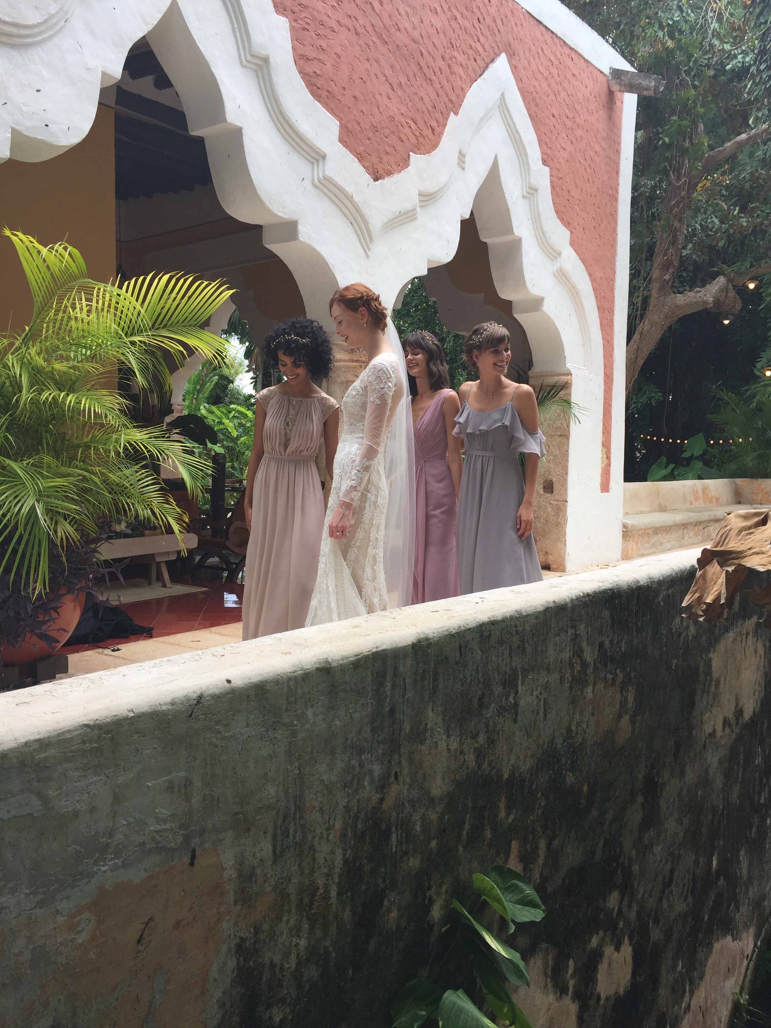 An ethereal bride and bridesmaids on set of the Fall 2017 Melissa Sweet collection photo shoot. See more on the David's Bridal blog - www.davidsbridal.com/blog.