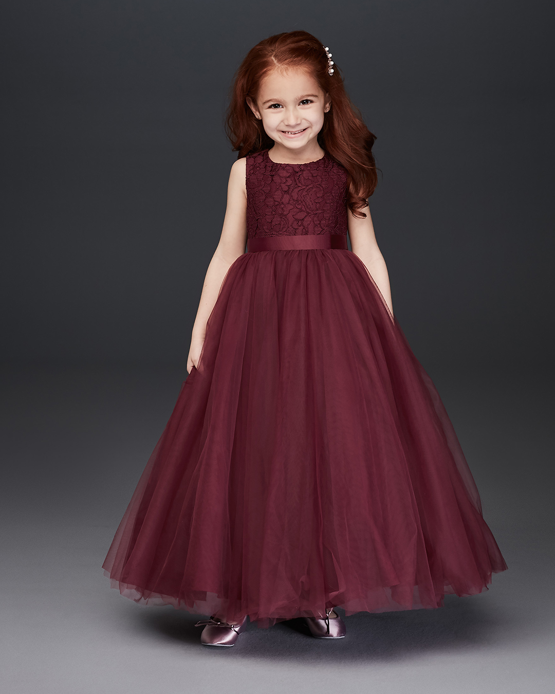 Flower girl in burgundy lace ball gown dress