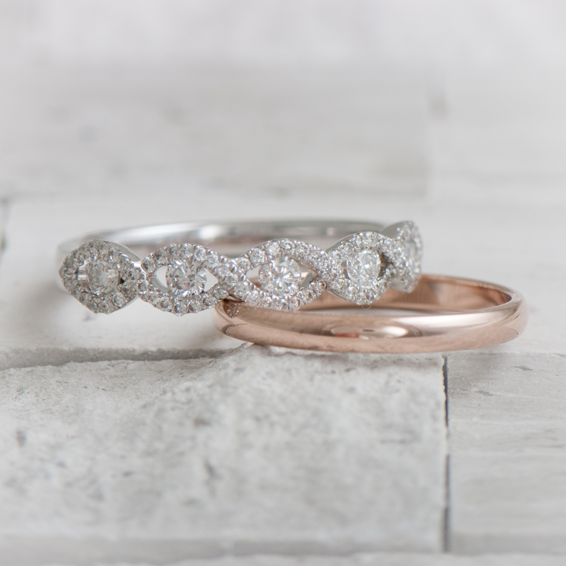 Diamond and rose gold wedding rings