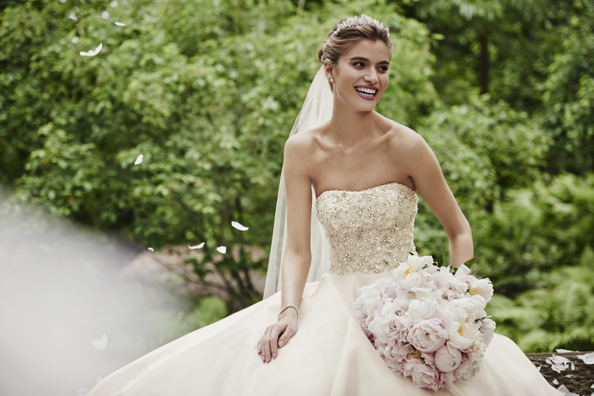A princess bride look featuring a gown from Oleg Cassini, exclusively at David's Bridal
