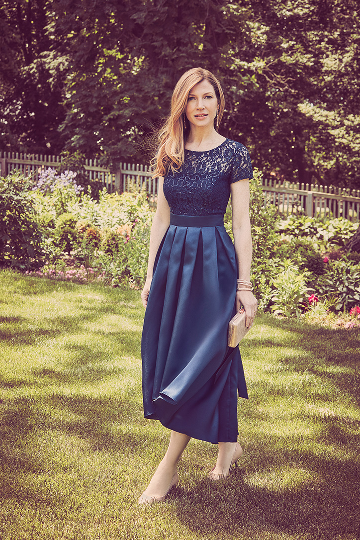 Woman in high-low blue occasion dress
