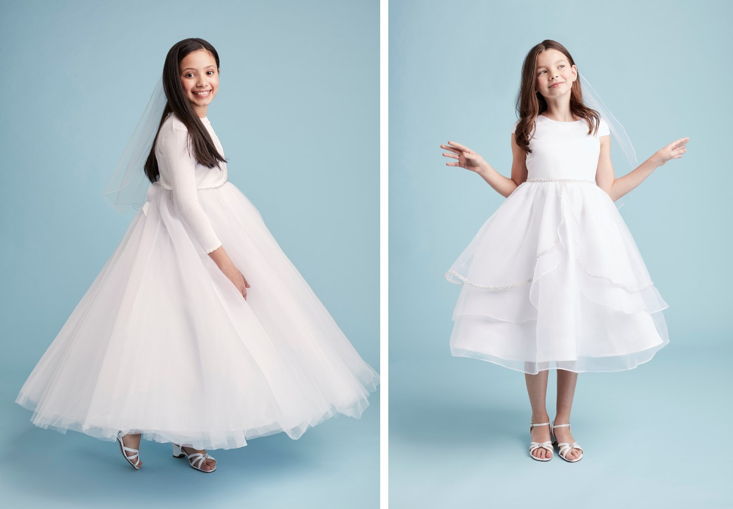 Two girls in white communion dresses