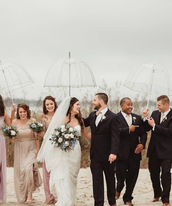 Tips for a Rainy Day Wedding. See more on the David's Bridal blog: www.davidsbridal.com/blog Image c/o @madeleineayers_
