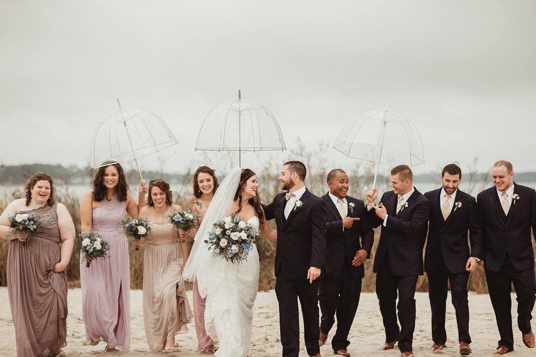 Tips for a Rainy Day Wedding. See more on the David's Bridal blog: www.davidsbridal.com/blog Image c/o @madeleineayers_
