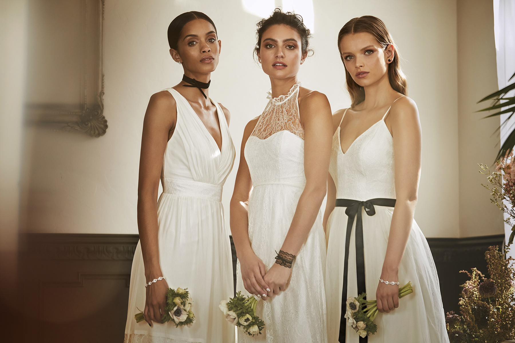 White bridesmaid dresses are a chic and timeless choice. Read more about an all-white bridal party on the David's Bridal blog - www.davidsbridal.com/blog