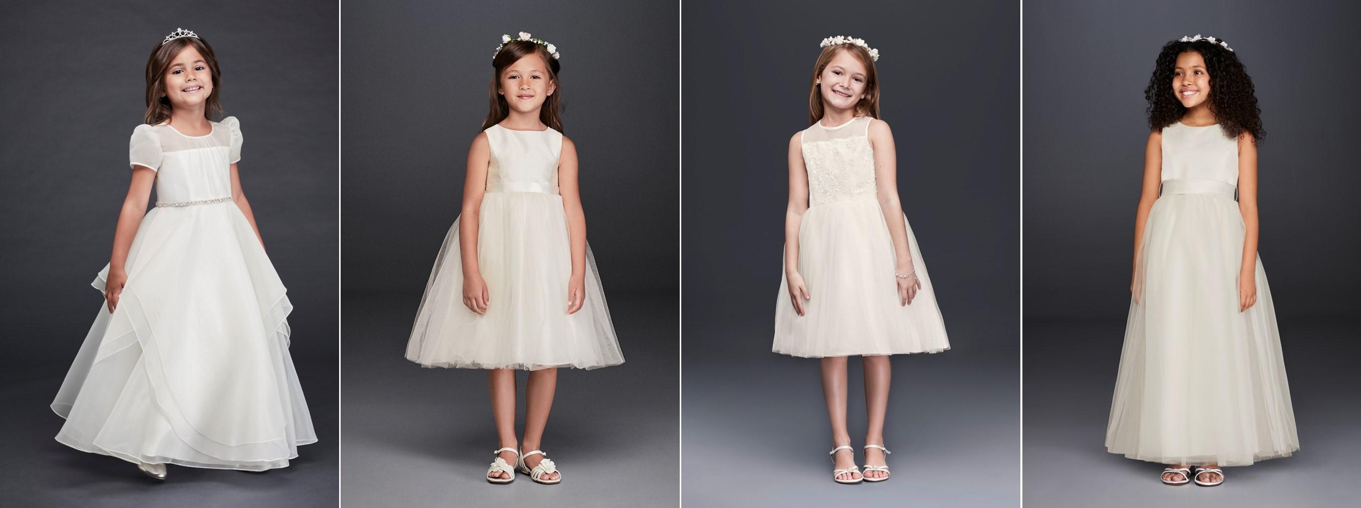 Girls in 4 short, white Meghan Markle flower girl look a like dresses