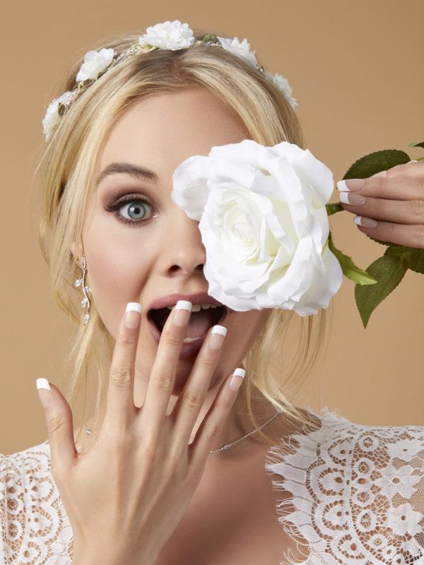 Bride wearing KISS faux eyelashes and nails
