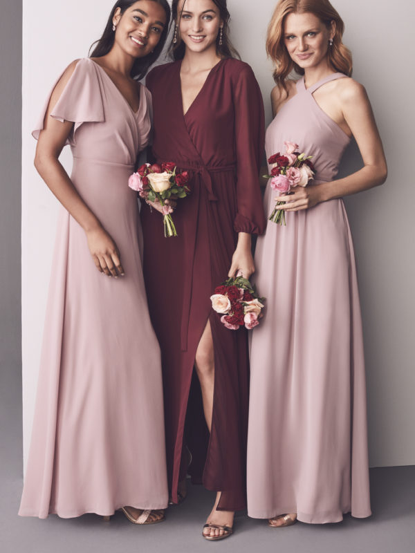 Group of 3 bridesmaids in shades of pink and red