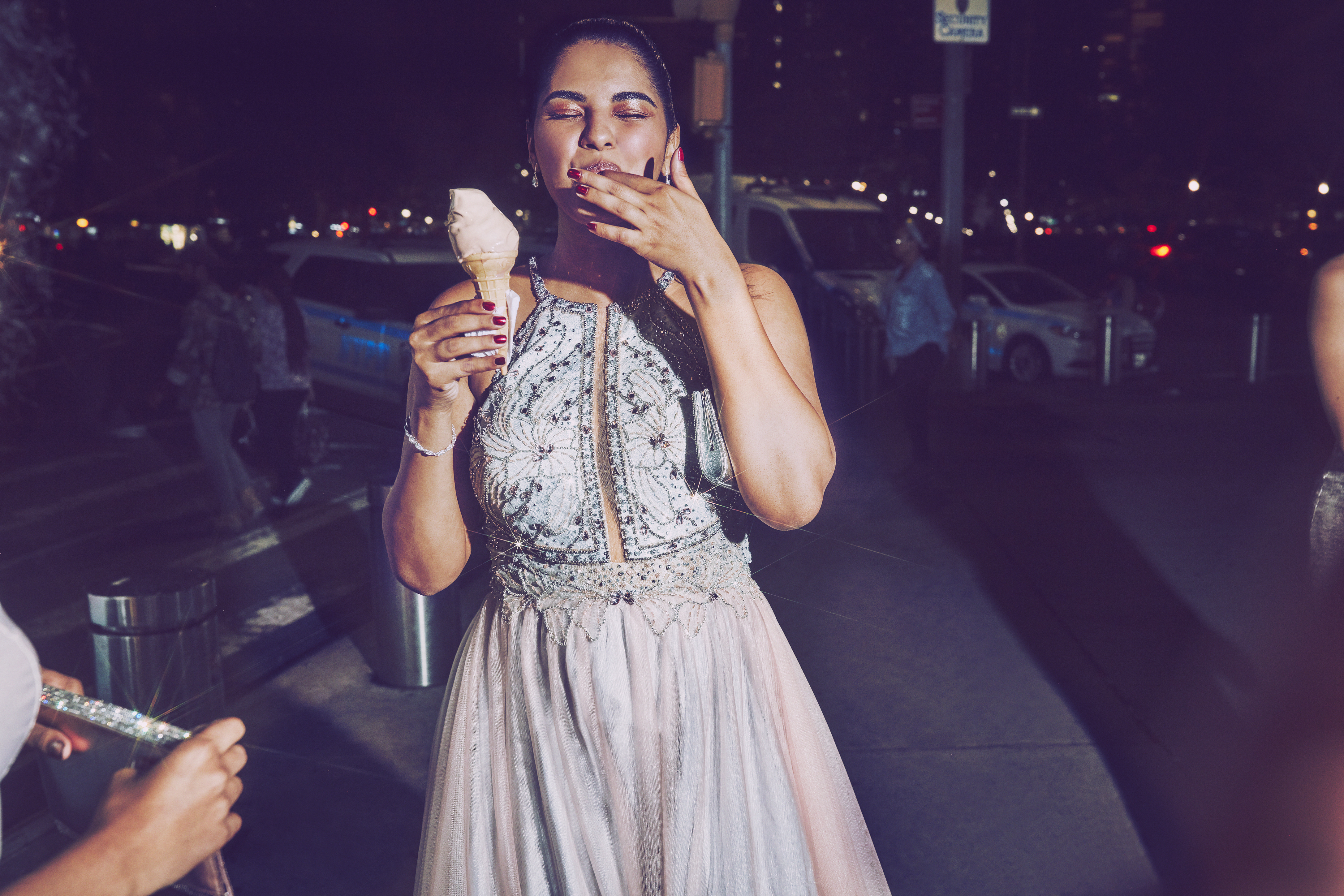 Girl eating ice cream in crystal long prom dress