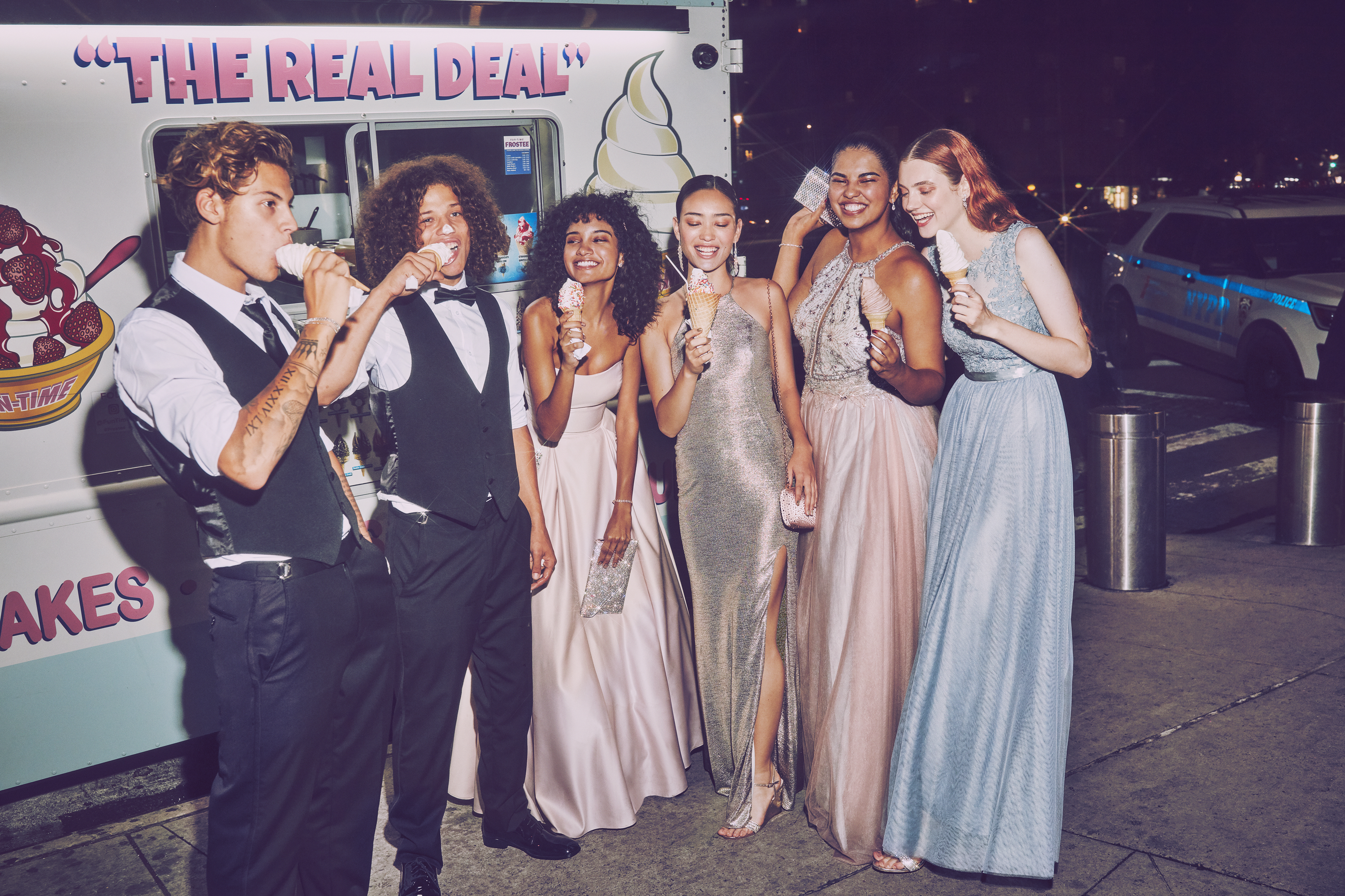 High School girls and boys eating ice cream in suits and long prom dresses