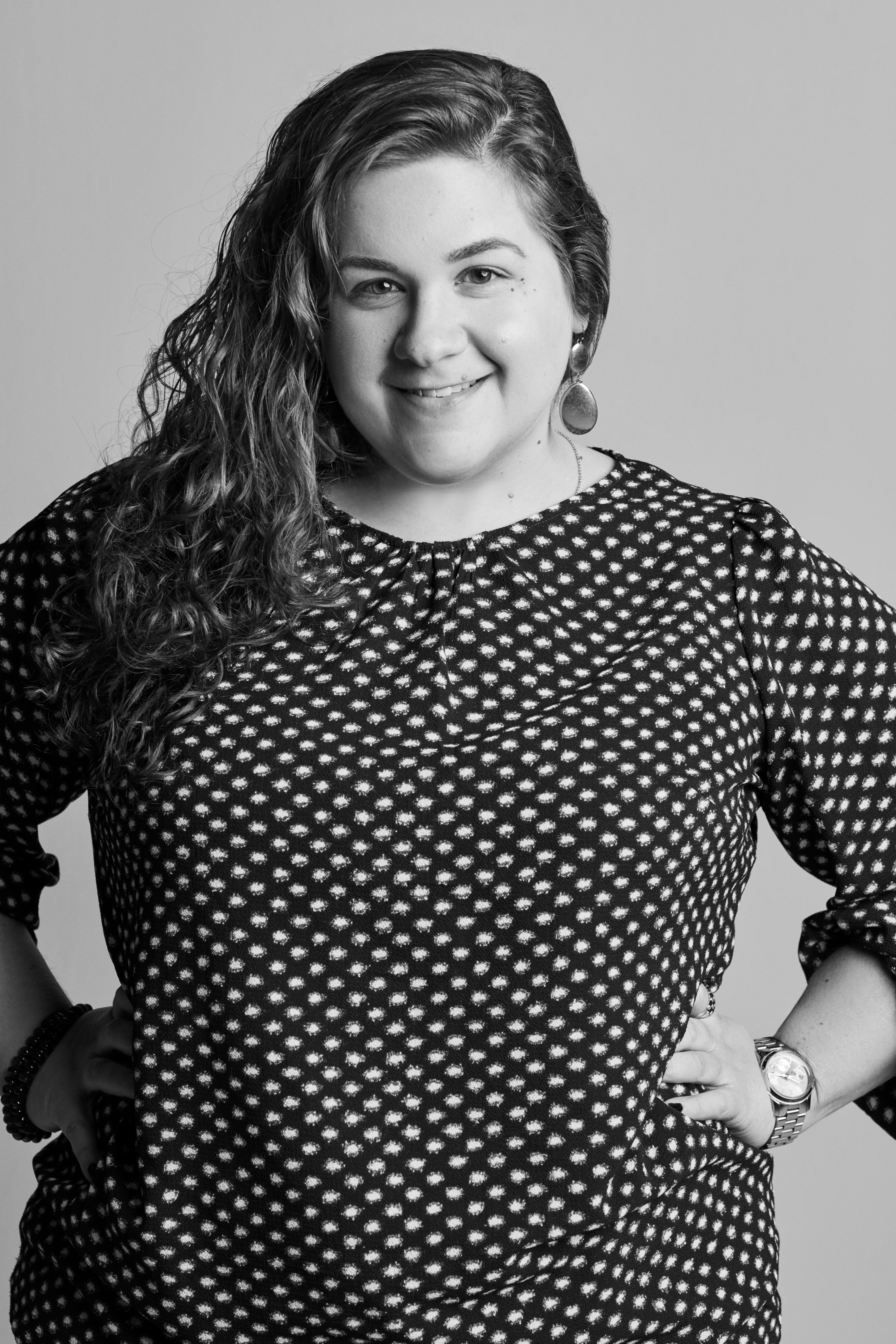 Angie,Procedures Designer for Store Operations(Woman in black and white polka dotted shirt)