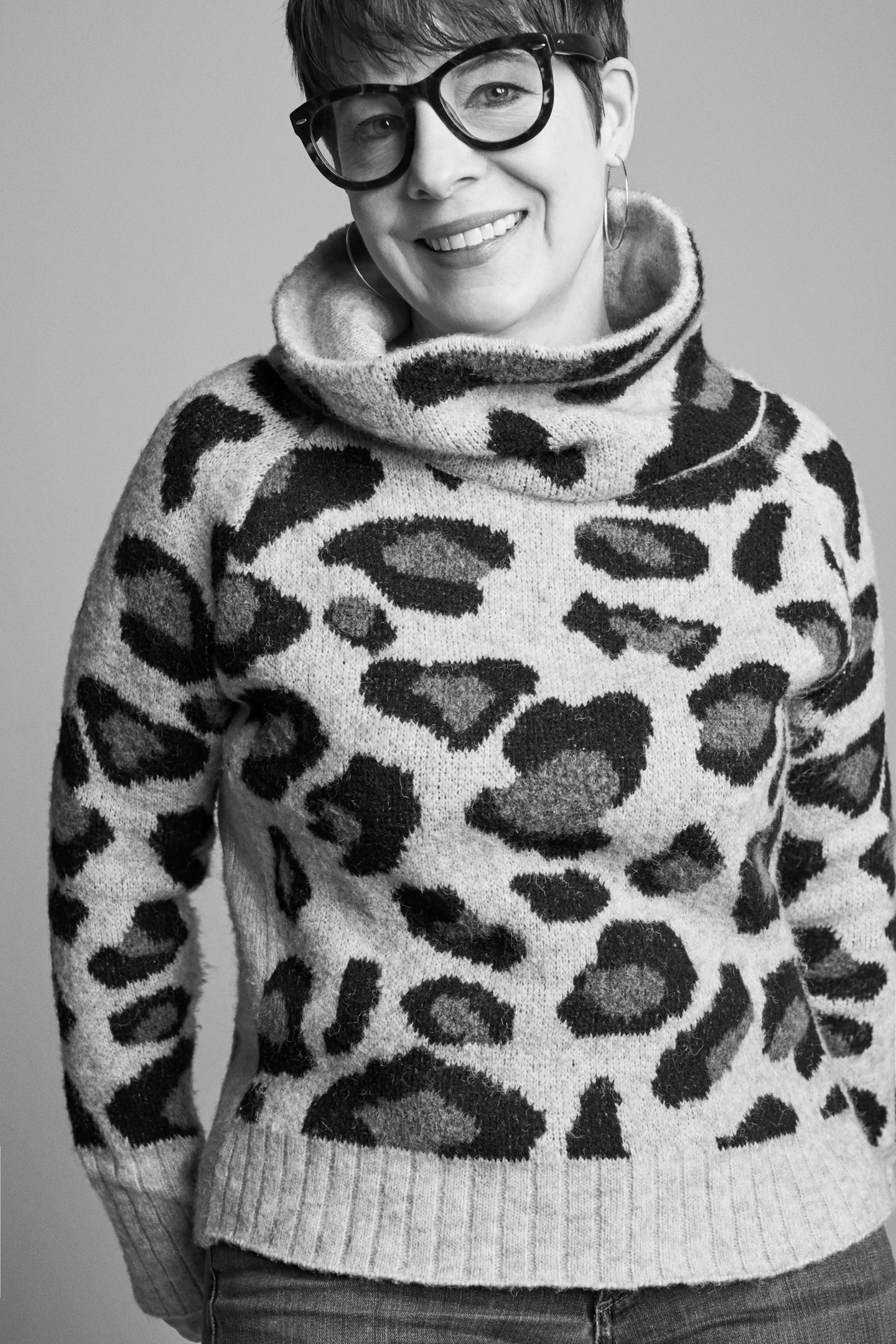 Mary Alice, David's Bridal's Director of Visual Merchandising (woman in leopard print sweater with over-sized glasses)