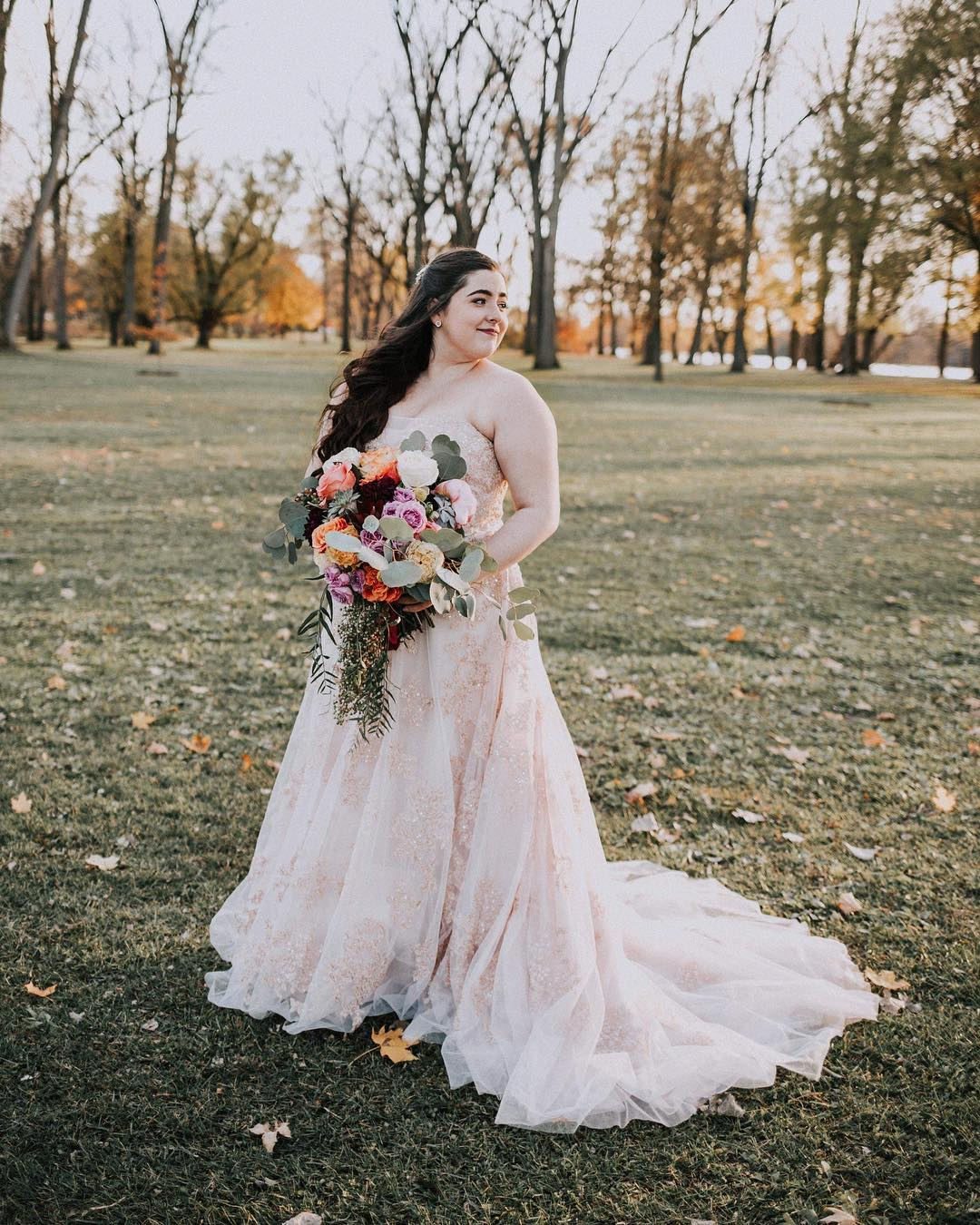 Bride in a strapless blush colored tulle ball gown