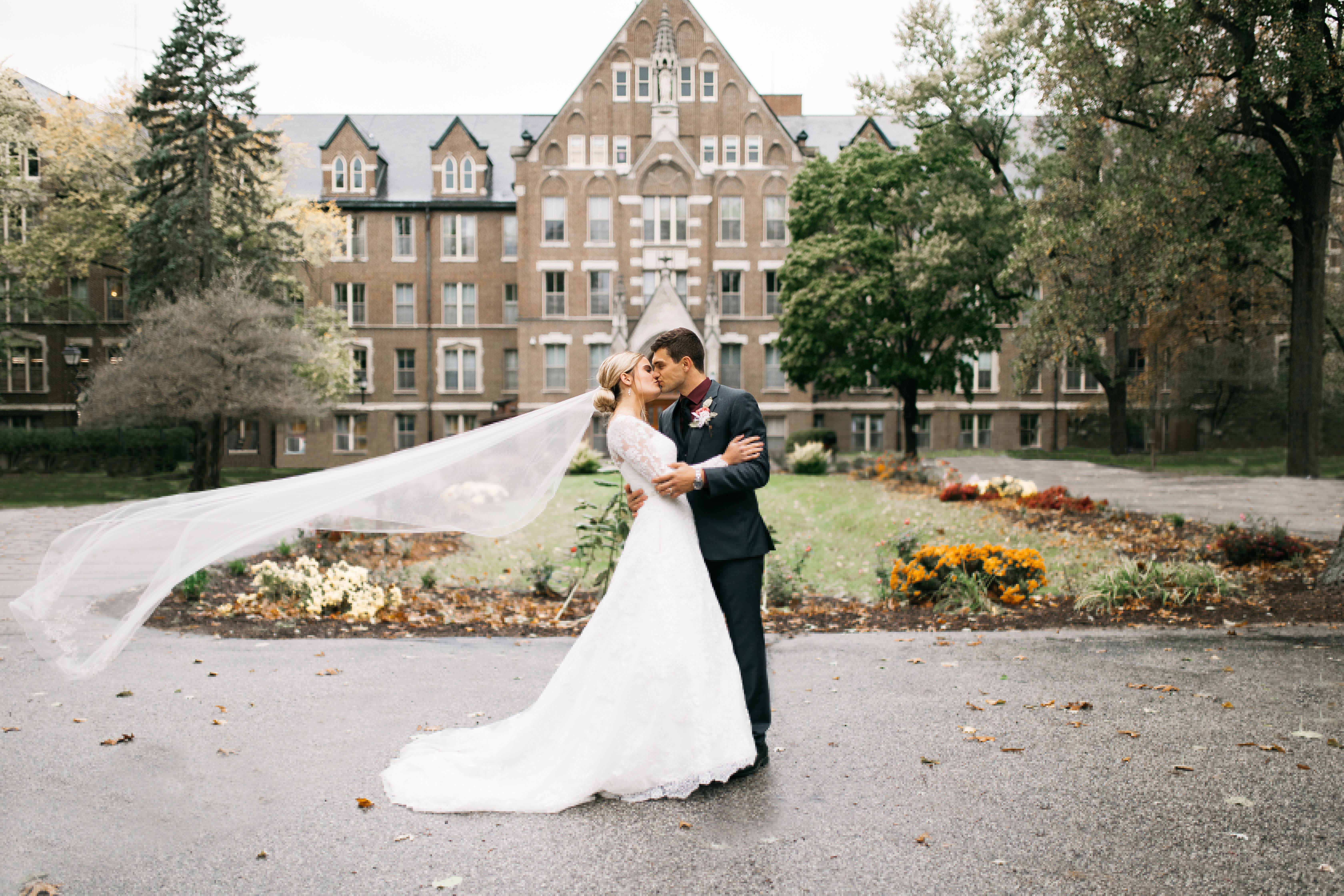 Bride with a cathedral length veil blowing in the wind     Insta-Worthy Veils