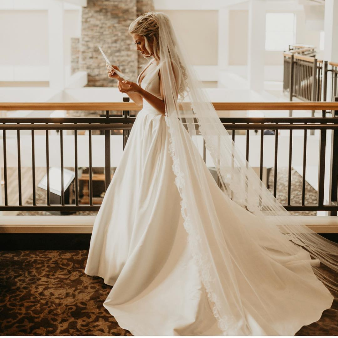 Bride in white dress and cathedral length veil     Insta-Worthy Veils