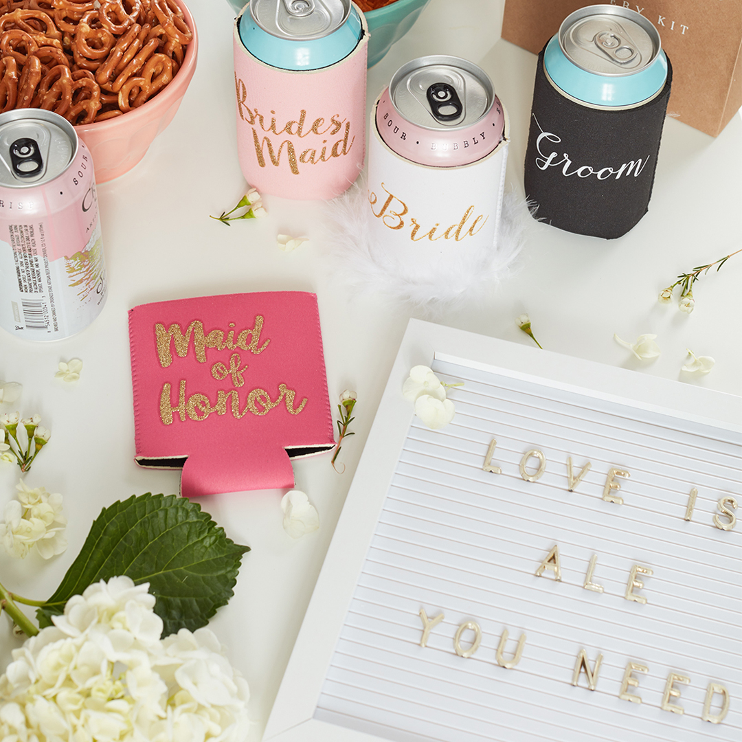 Beer wedding accessories with koozies and 'Love is Ale You Need' letterboard sign