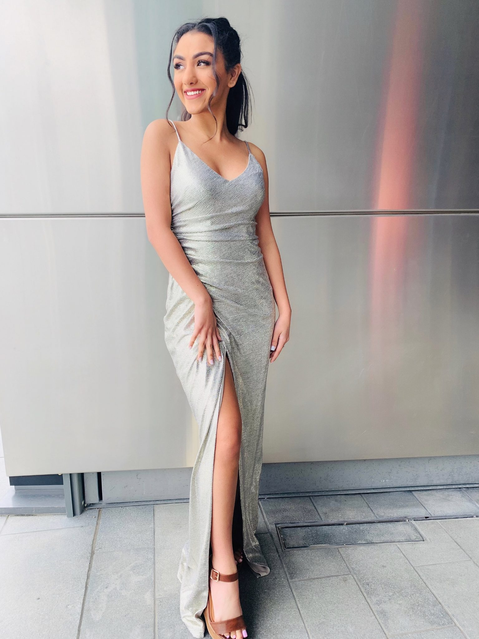 Girl smiling in metallic sheath dress for a college formal