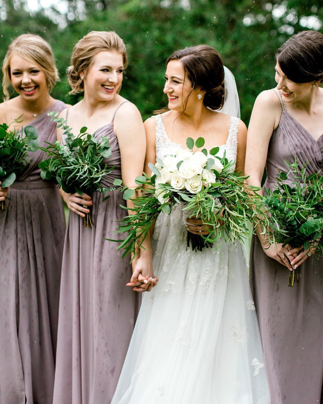 Bridesmaids holding bouquets made of leafy greenery | Nontraditional Wedding Bouquet Ideas