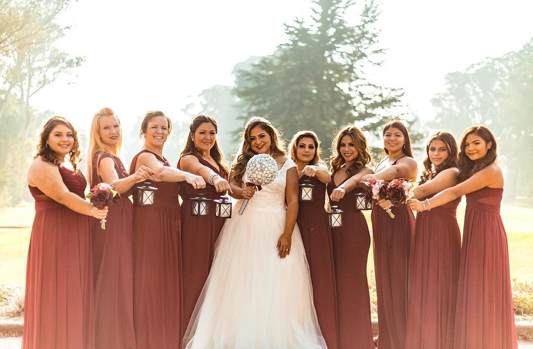 Bridesmaids holding small lanterns | Nontraditional Wedding Bouquet Ideas