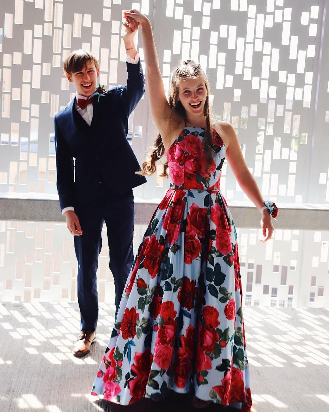Boy twirling girl in long floral print prom dress from David's Bridal | Prom 2019 Dress Ideas