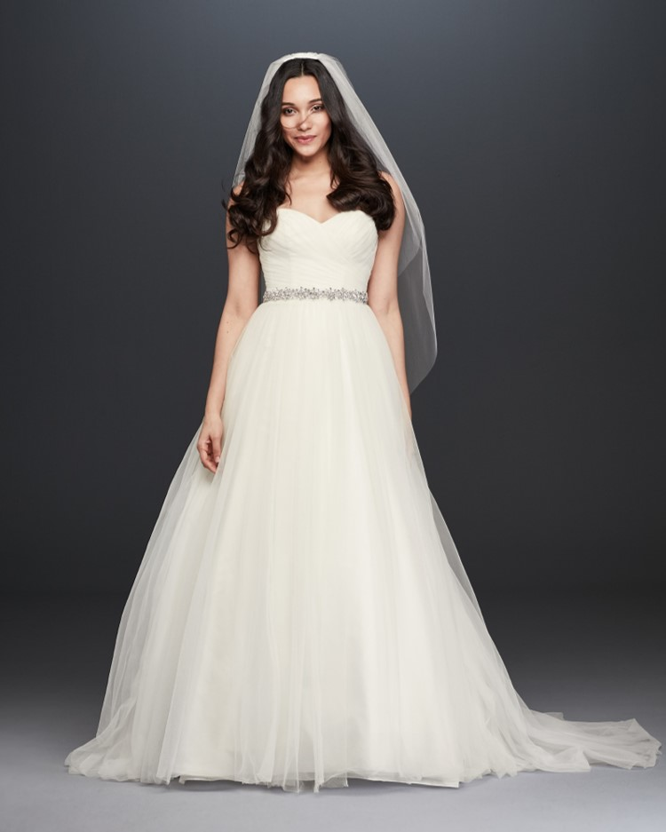 Bride in strapless tulle ball gown wedding dress from David's Bridal's affordable wedding dresses assortment