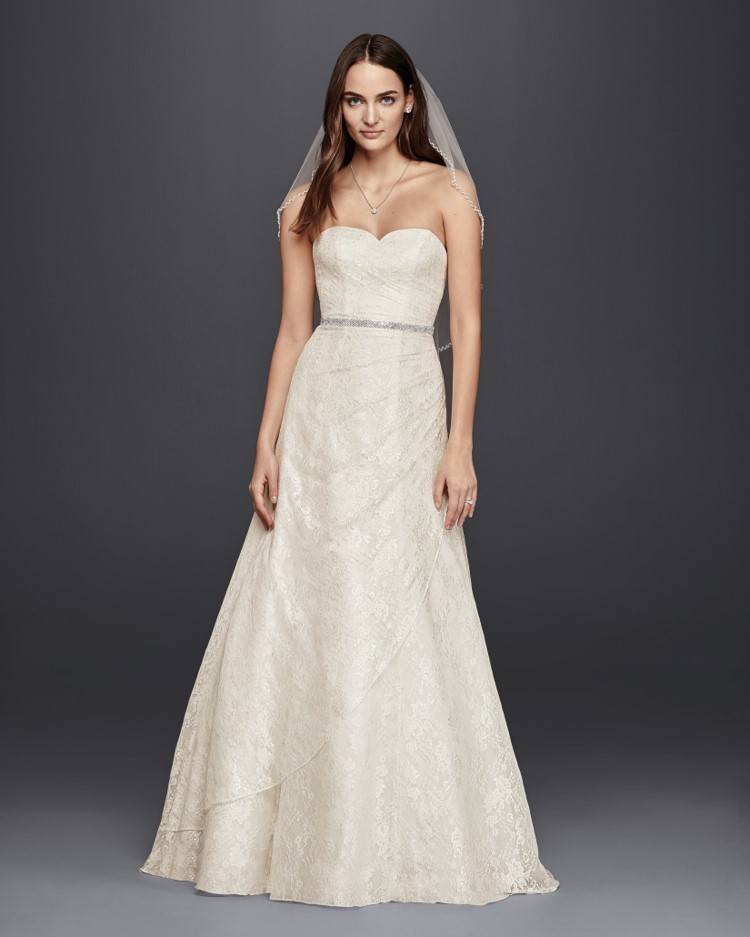 Bride in strapless lace A-line wedding dress from David's Bridal's affordable wedding dresses assortment