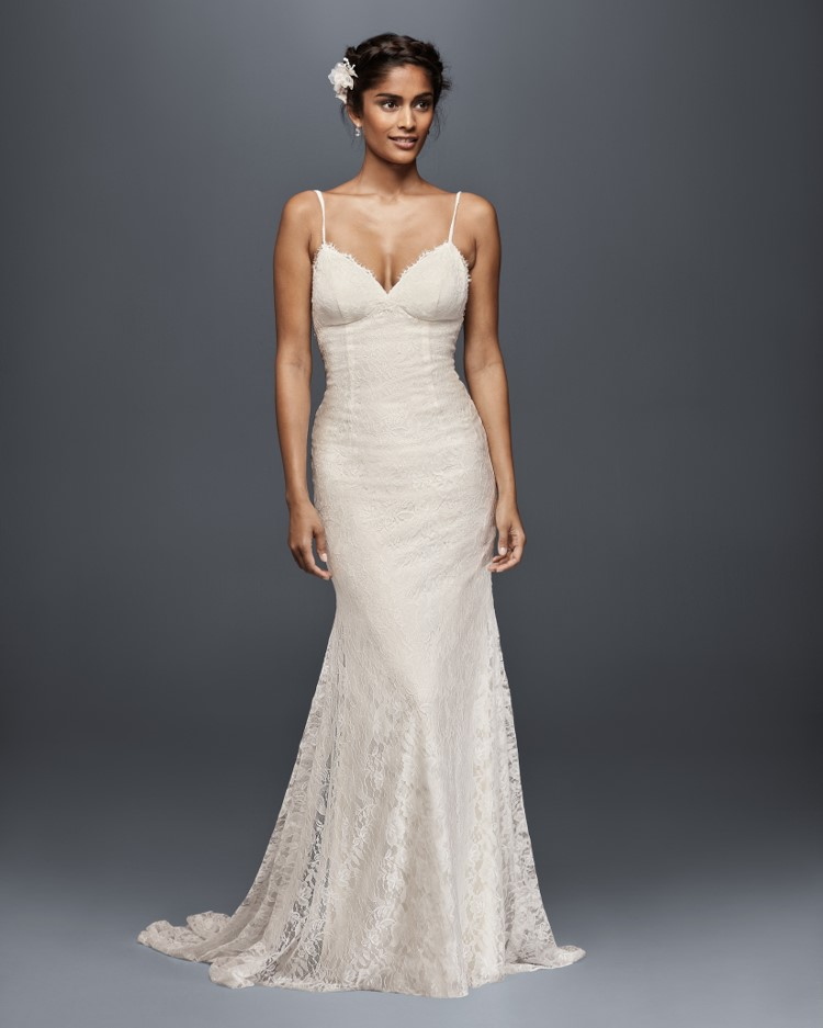 Bride in spaghetti strap lace sheath wedding dress from David's Bridal's affordable wedding dresses assortment