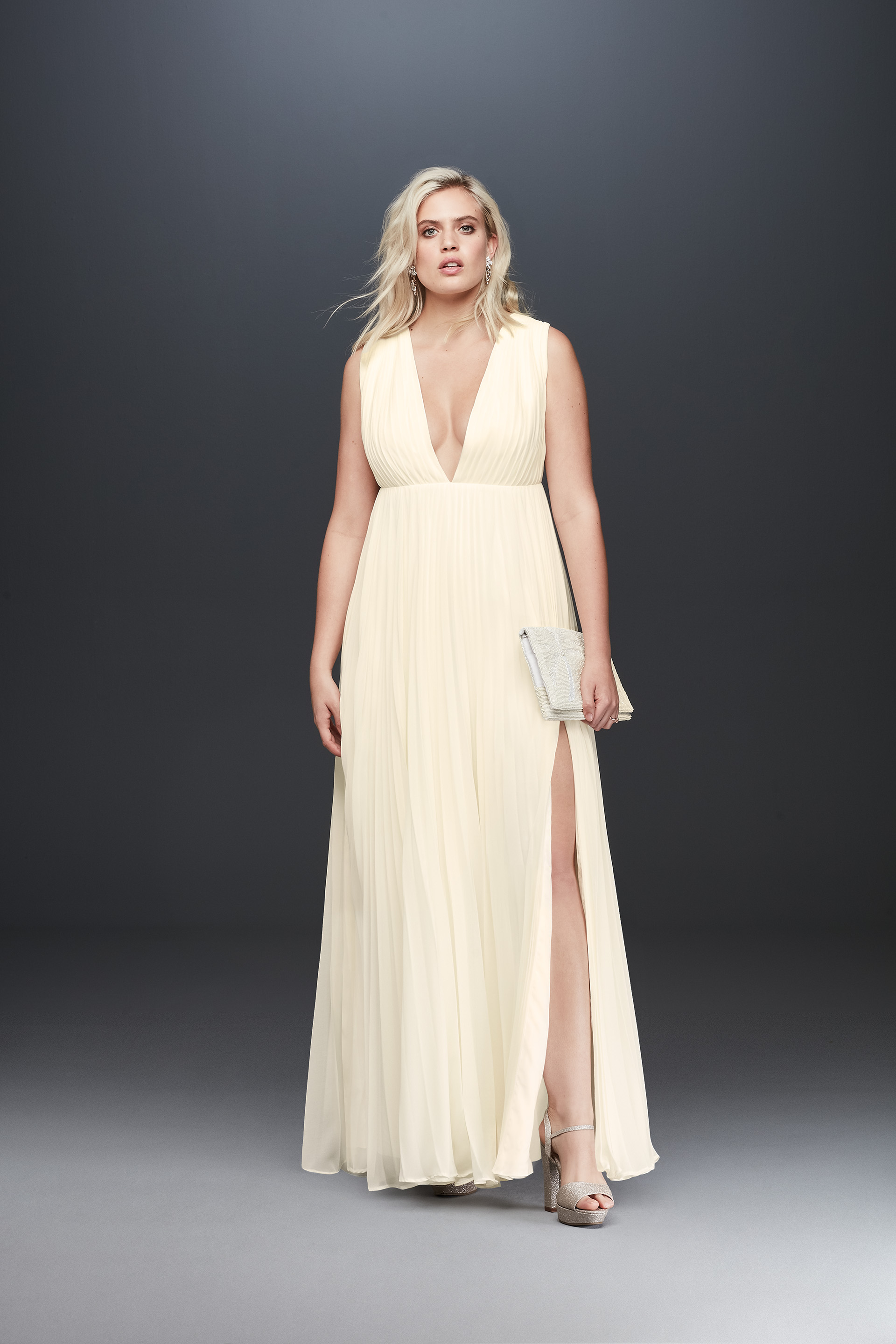 Bride in tank plunging neckline wedding dress from Fame & Partners x David's Bridal collection