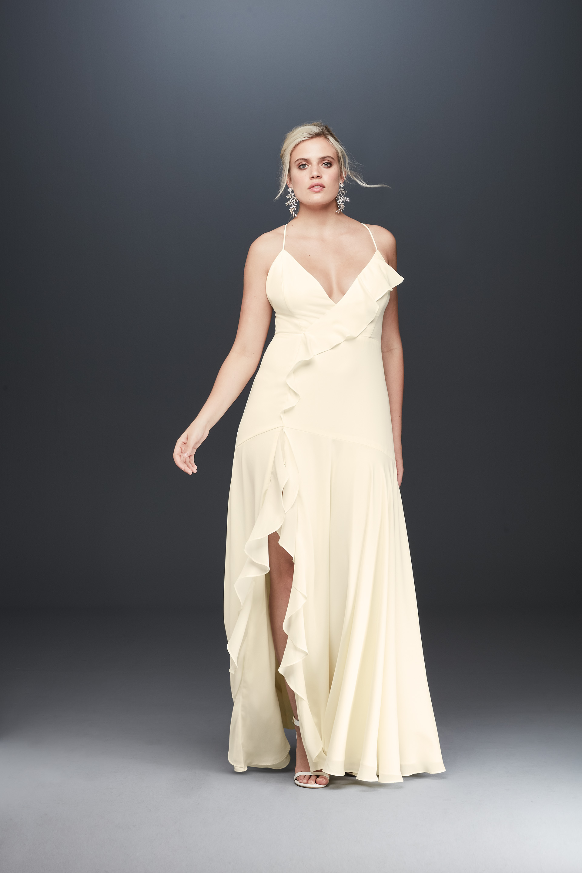 Bride in spaghetti strap ruffled wedding dress from Fame & Partners x David's Bridal collection
