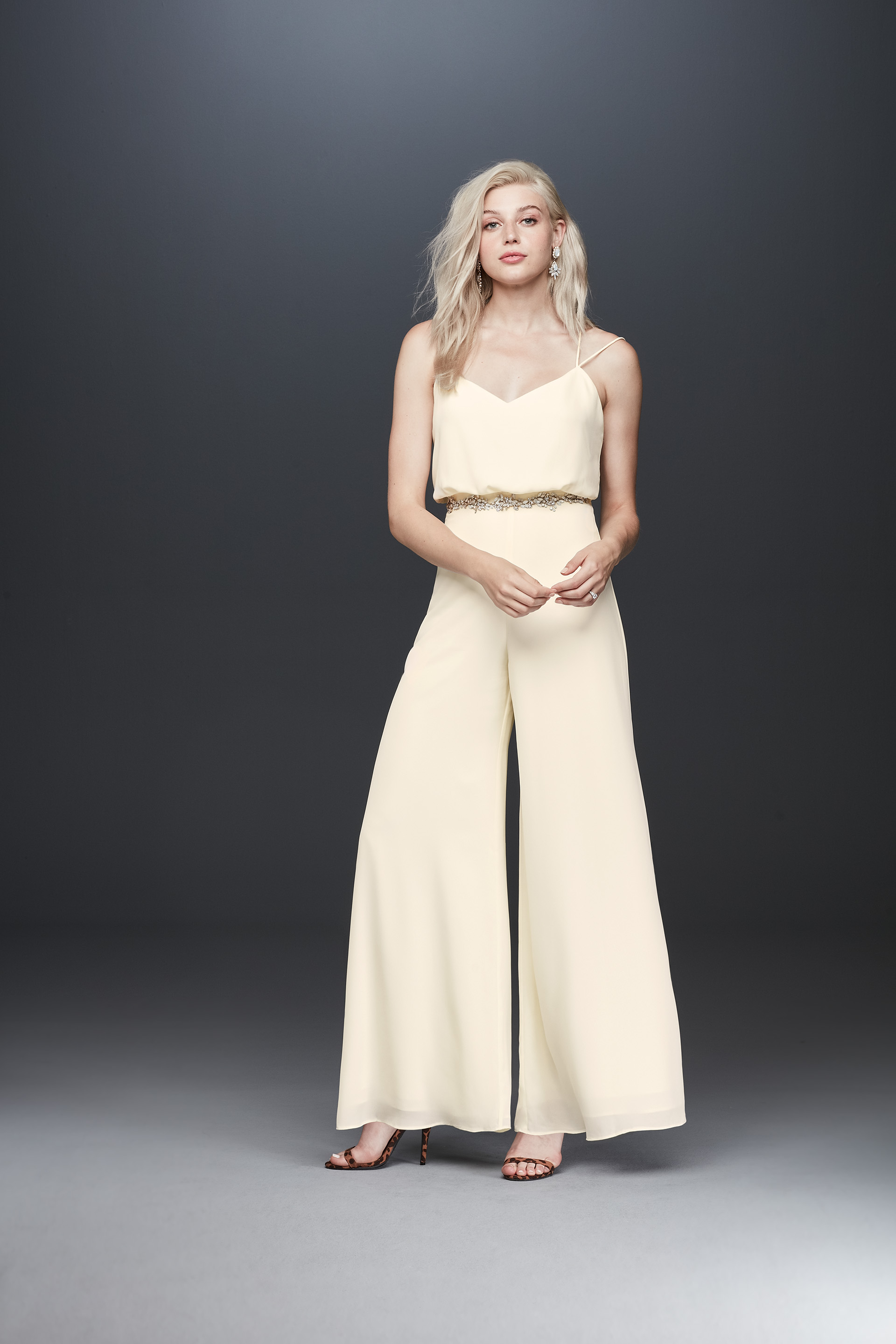 Bride in spaghetti strap bridal jumpsuit from Fame & Partners x David's Bridal collection