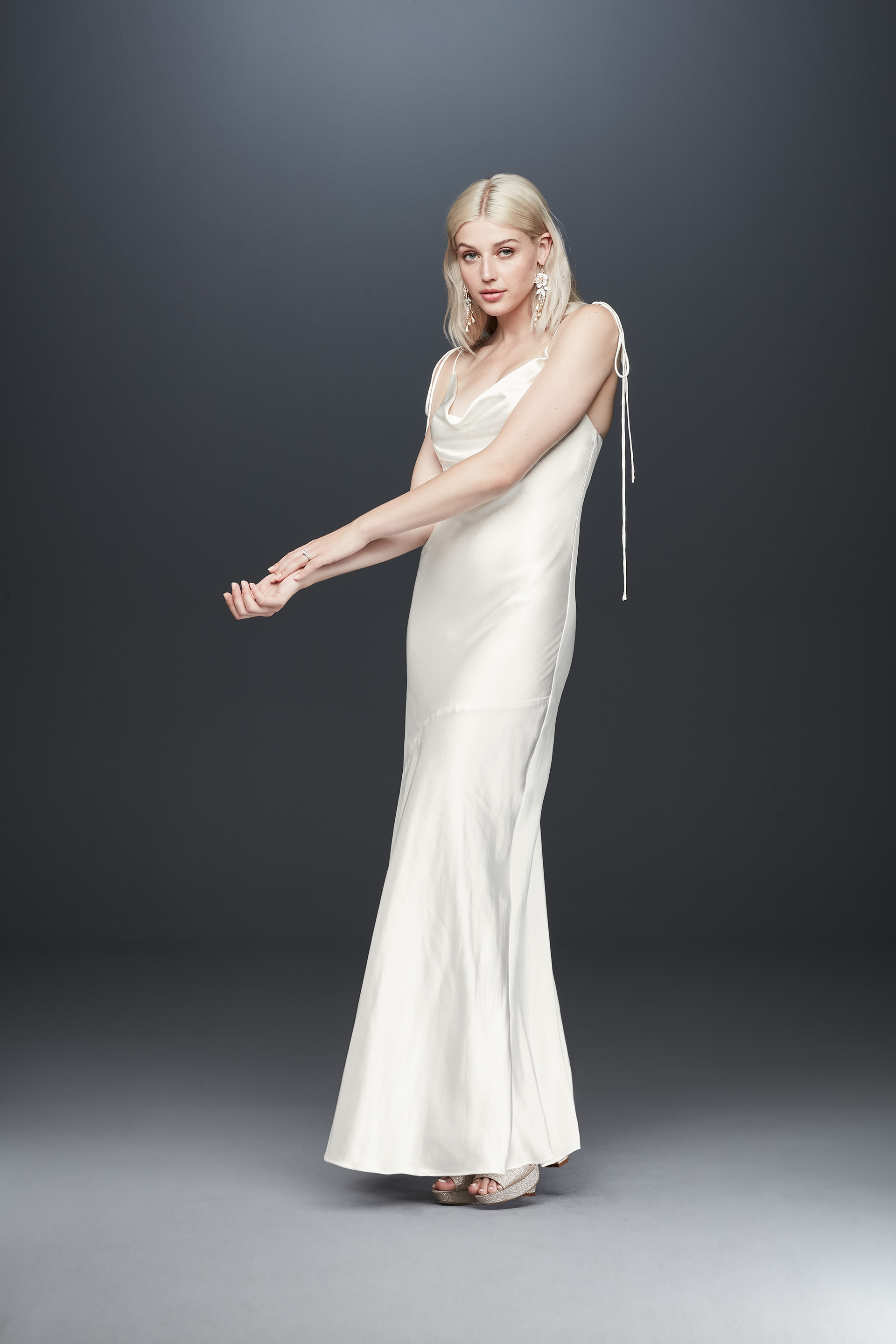 Bride in cowl neck long satin wedding dress from Fame & Partners x David's Bridal collection