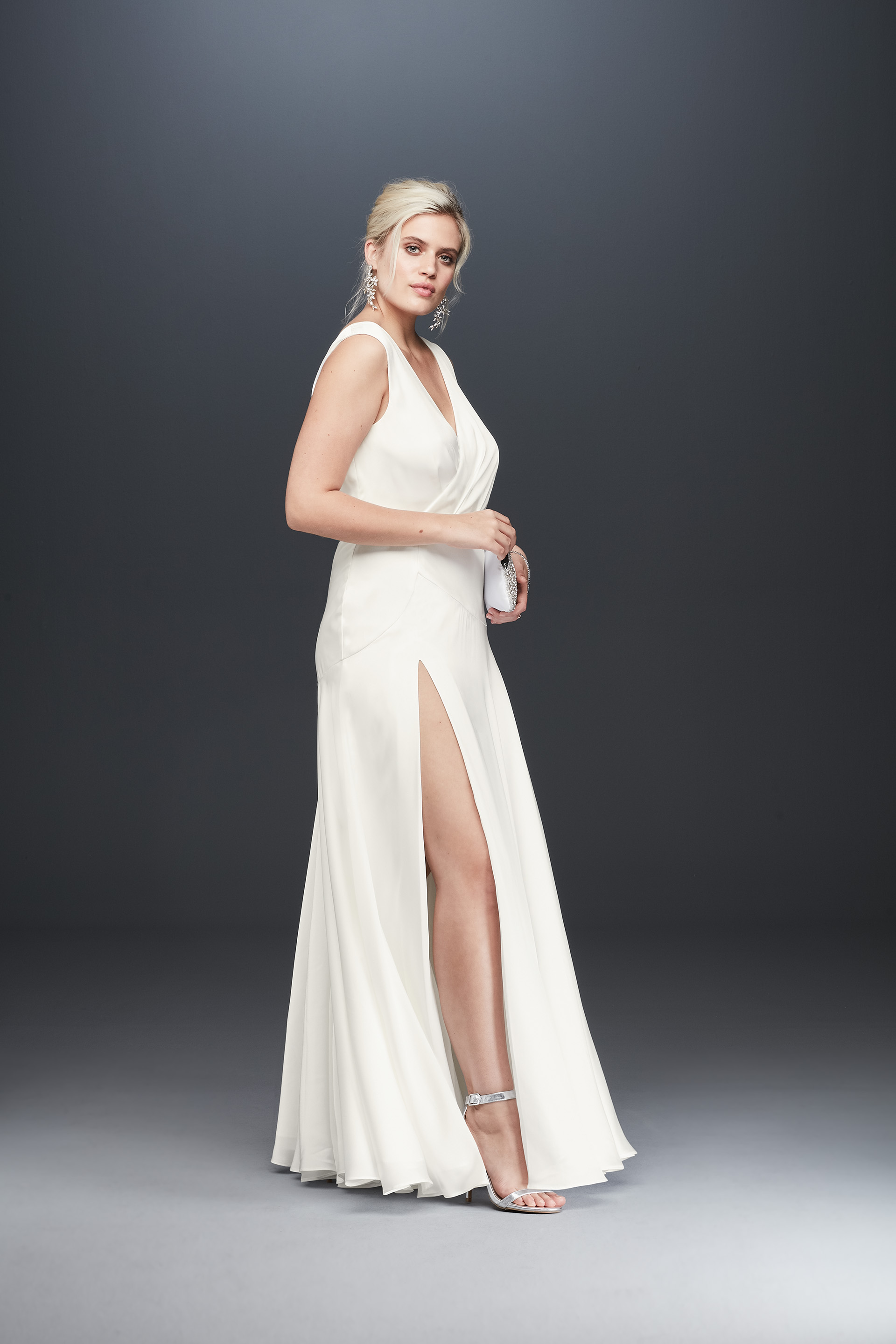 Bride in sating tank long wedding dress with slit from Fame & Partners x David's Bridal collection