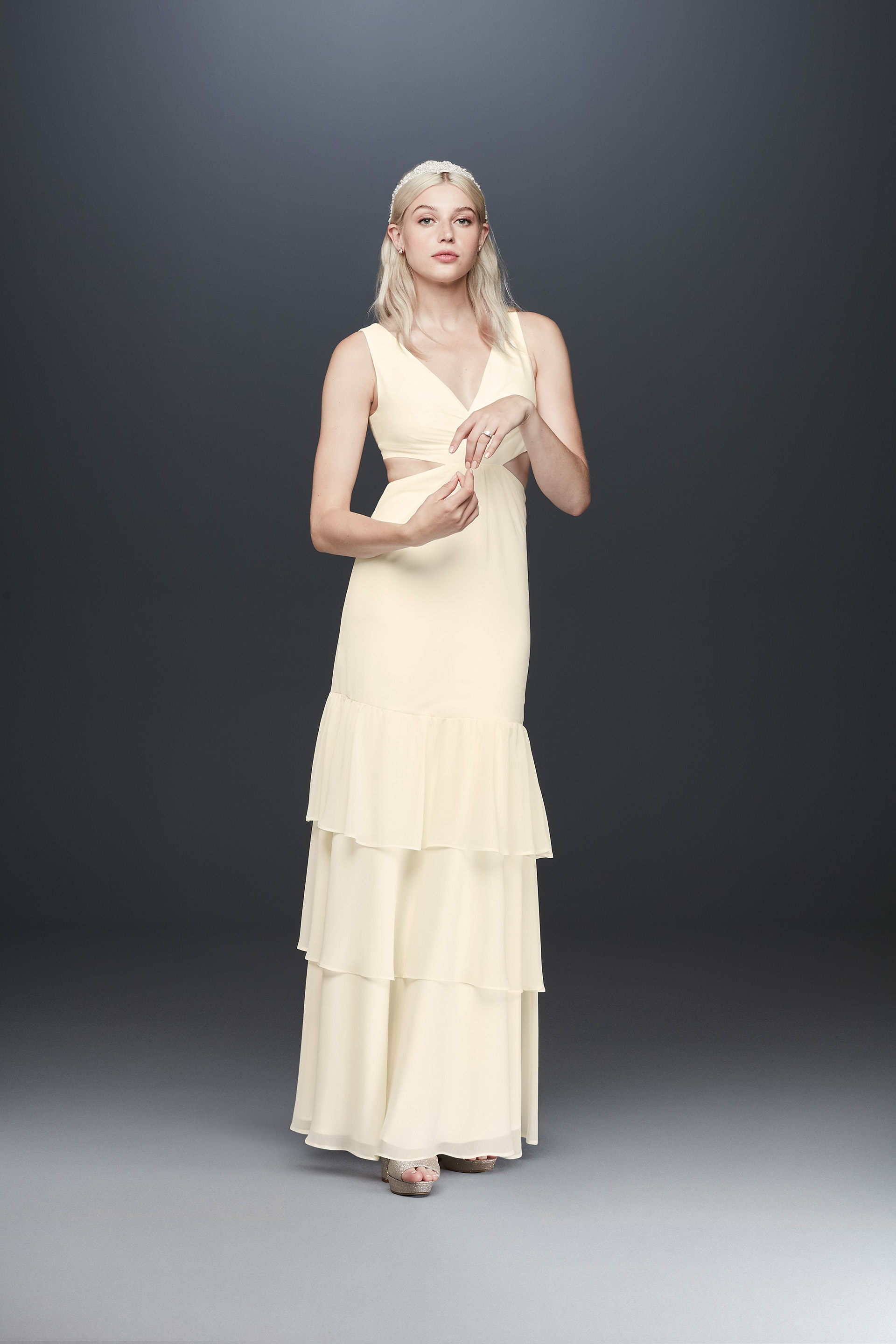 Bride tiered skirt wedding dress with side cutouts from Fame & Partners x David's Bridal collection