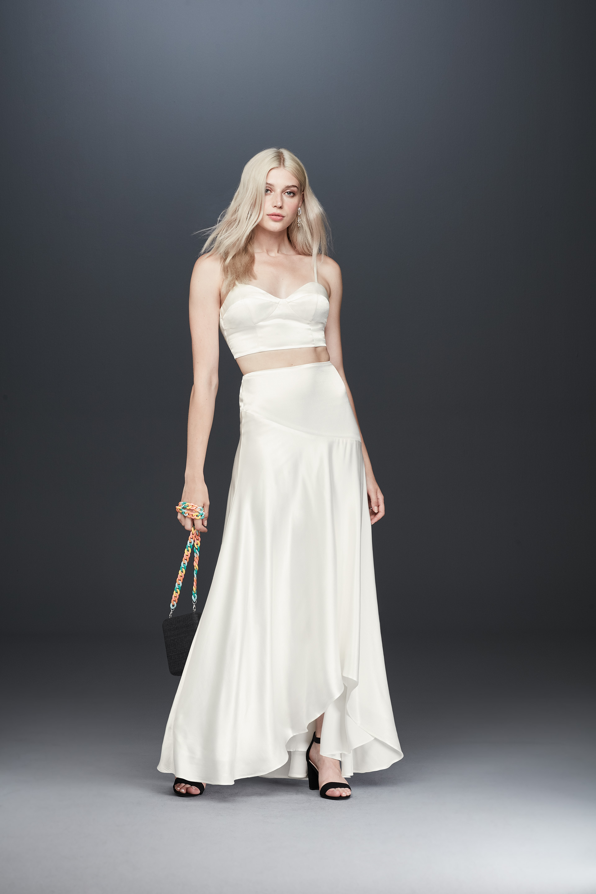 Bride in spaghetti strap satin bridal two piece dress from Fame & Partners x David's Bridal collection