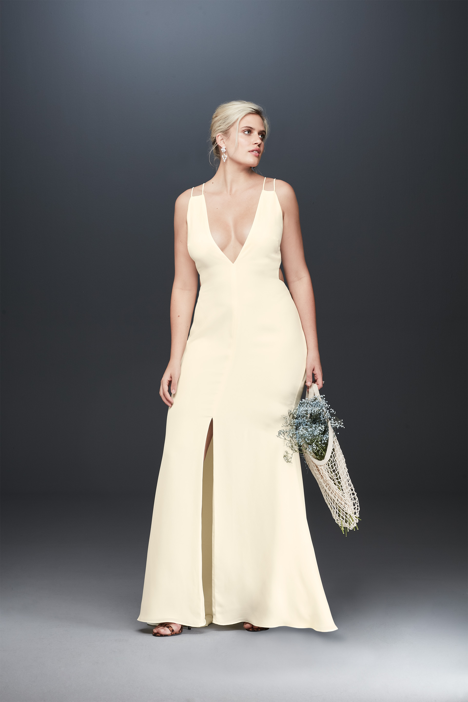 Bride looking away in double strap plunging neckline wedding dress from Fame & Partners x David's Bridal collection