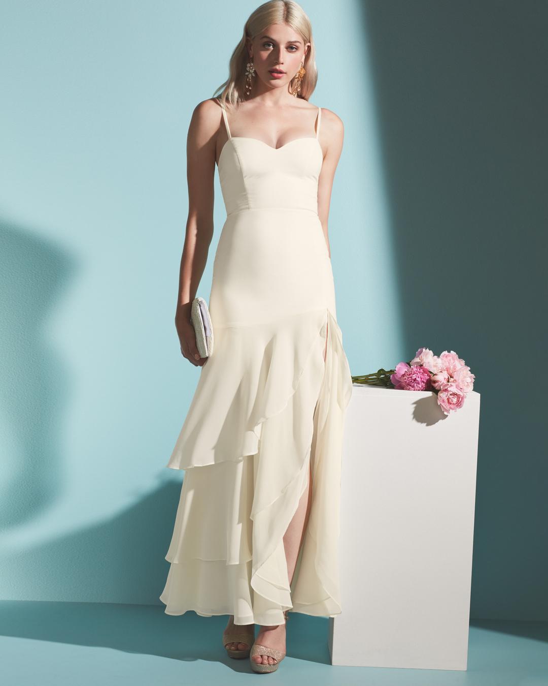Bride in long ruffled wedding dress by Fame & Partners x David's Bridal