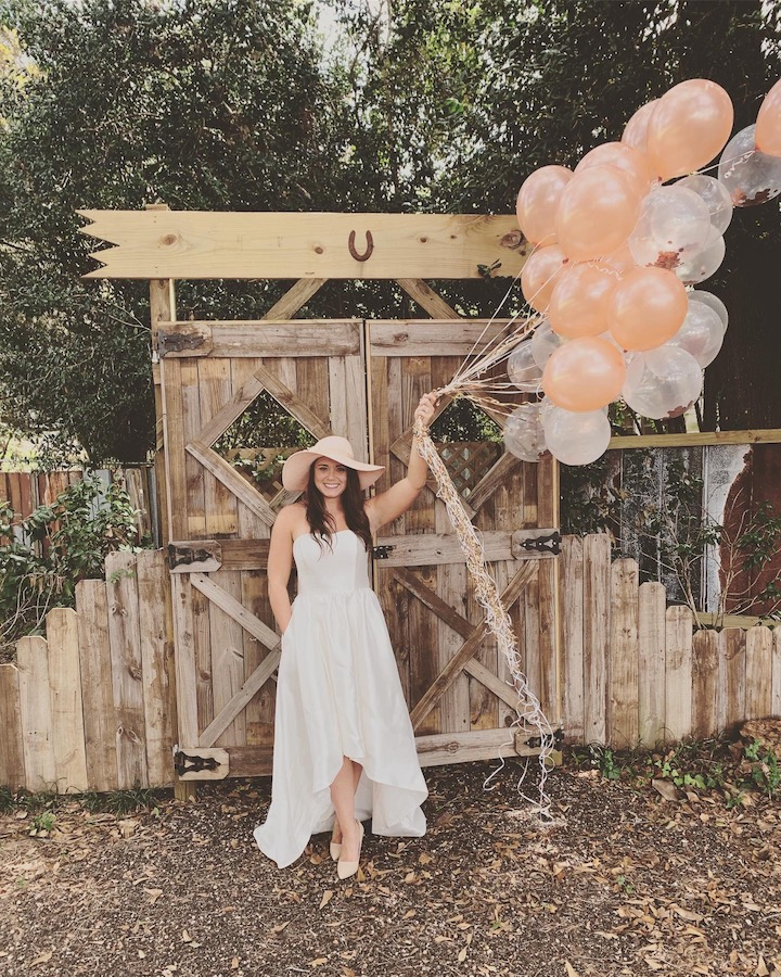bride to be holding balloons