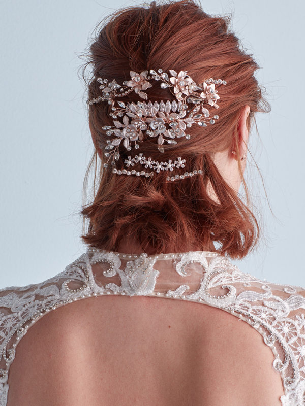 Wedding hairstyle with layered combs and pins in middle of hair