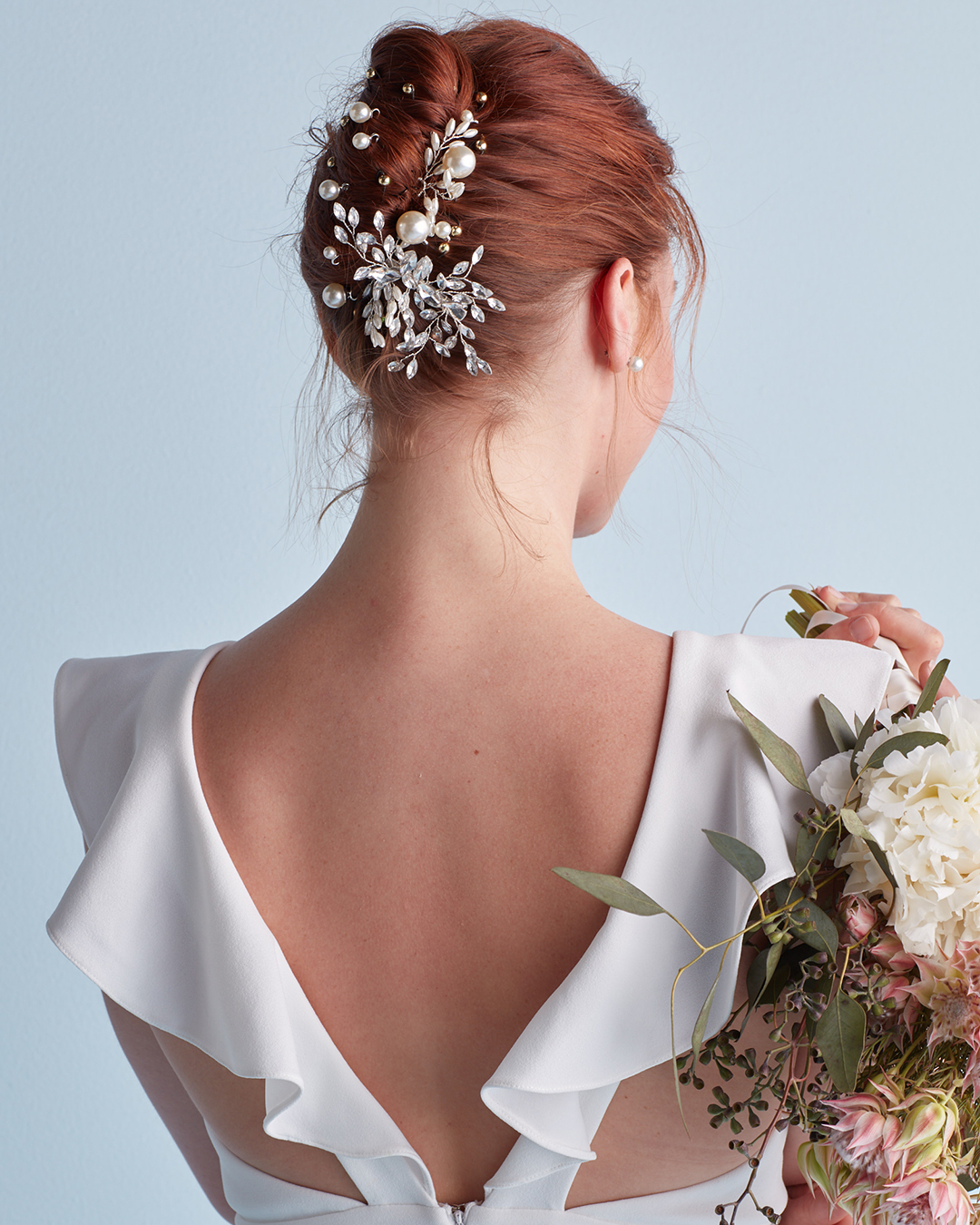 French twist wedding hairstyle with pins and clips