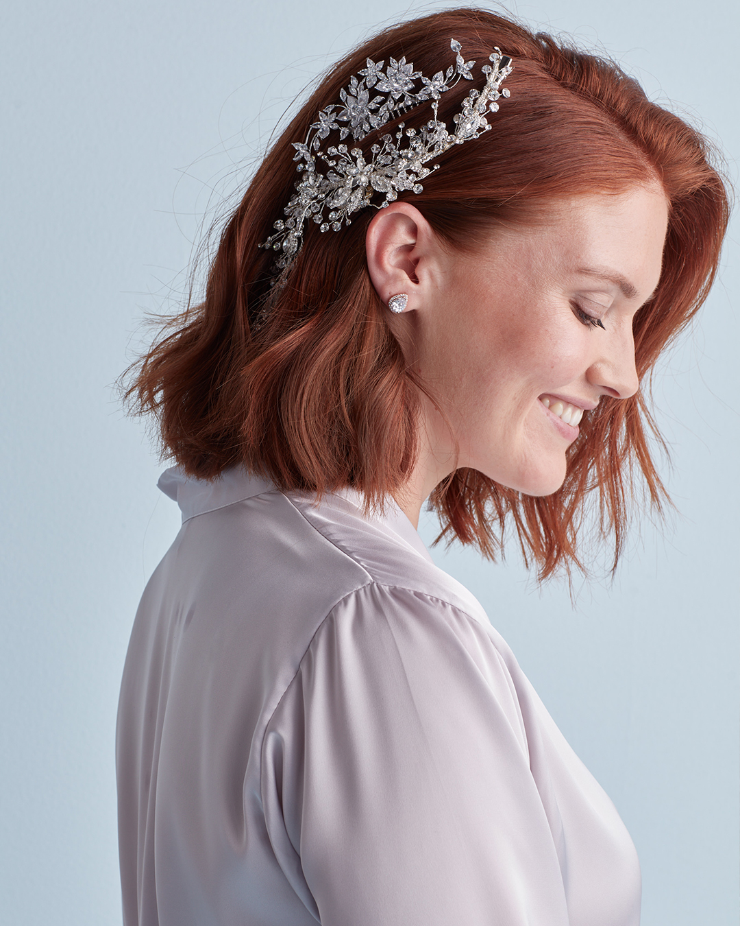 Down wedding hairstyle with layered clips