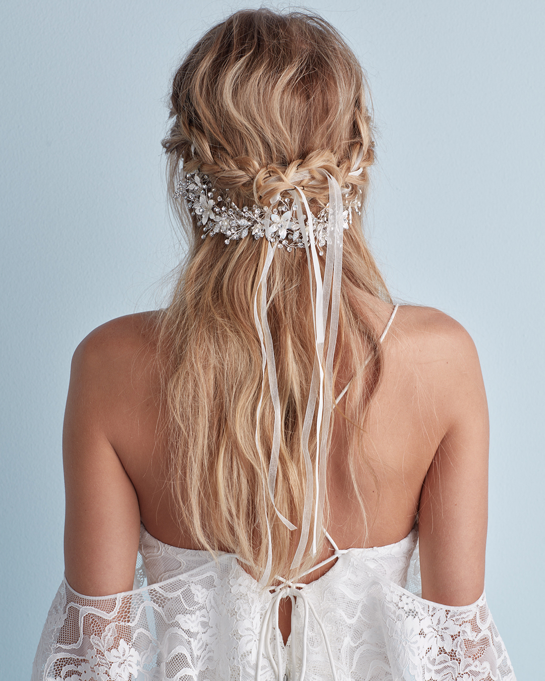 Wedding hairstyle with braid and crystal headband in half-up style
