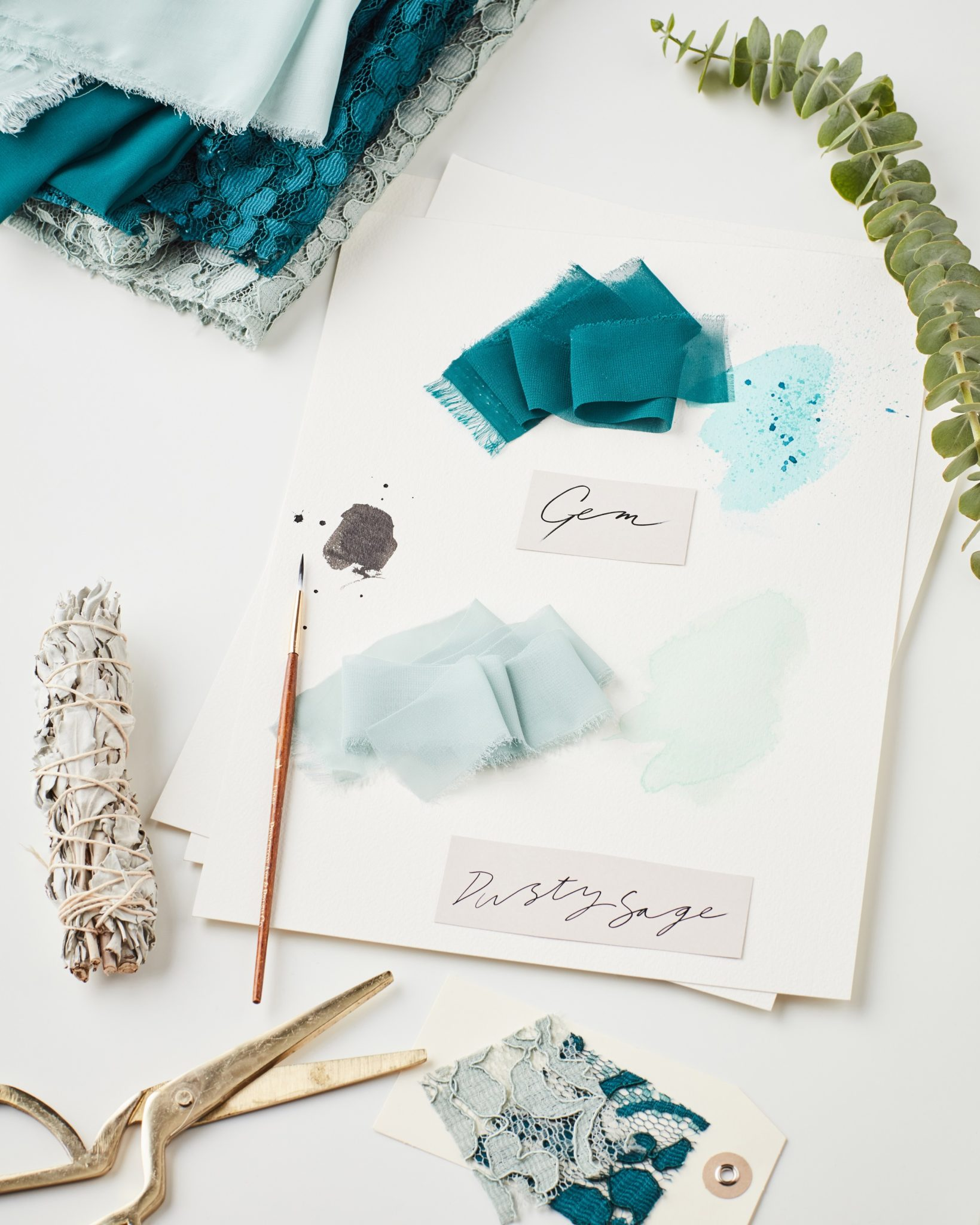 Green bridesmaid color swatches on design table