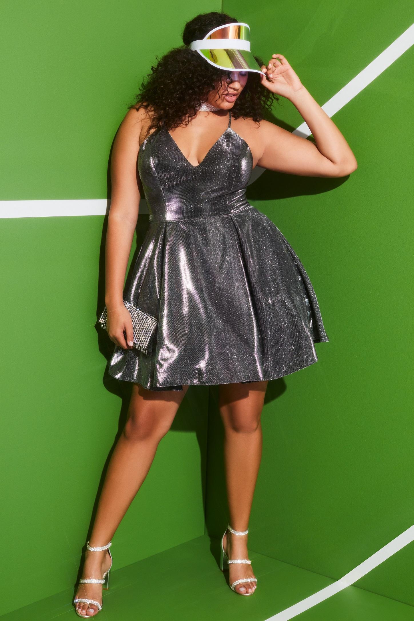 Girl in silver metallic short homecoming dress
