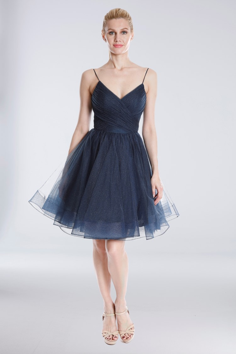 Girl in short blue tulle glitter homecoming dress