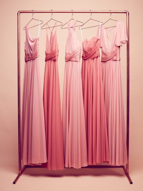Coral dresses hanging on a rack