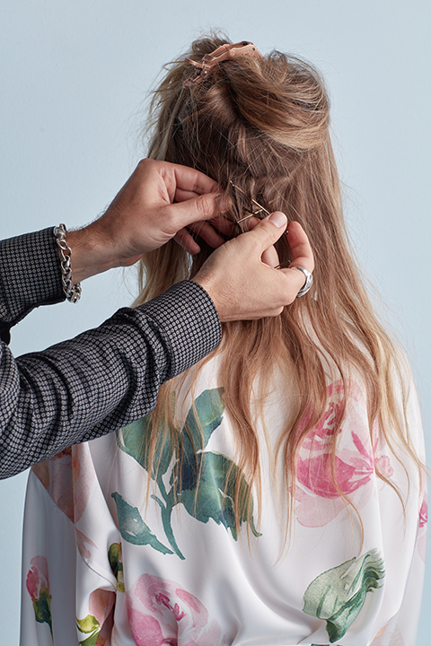 Hair stylist pinning bobby pins in hair